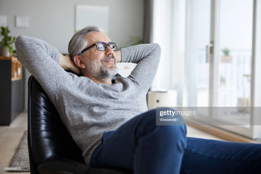 Portrait of mature man relaxing at home : Photo