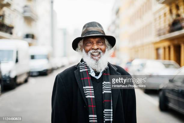 portrait of mature man smiling - african american 70s fashion stock photos and pictures
