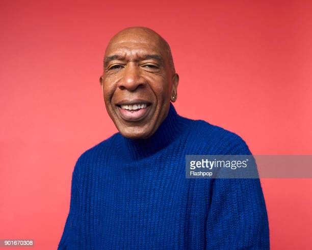 portrait of mature man smiling - turtleneck stock pictures, royalty-free photos & images