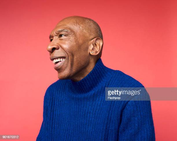 portrait of mature man smiling - colored background stock pictures, royalty-free photos & images