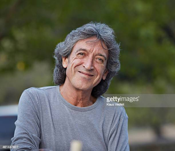portrait of mature man smiling to camera - klaus vedfelt mallorca stock pictures, royalty-free photos & images