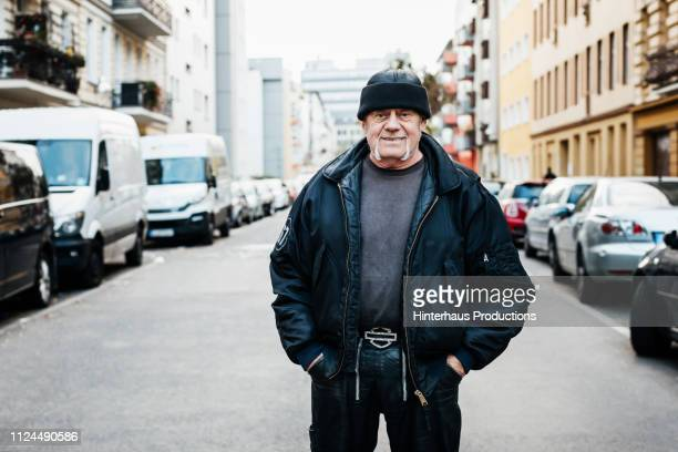 portrait of mature man wearing bomber jacket - green coat stock pictures, royalty-free photos & images