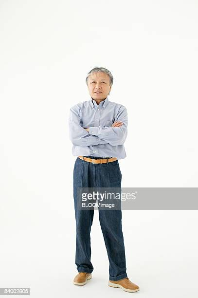 Portrait of Mature man with arms folded, studio shot