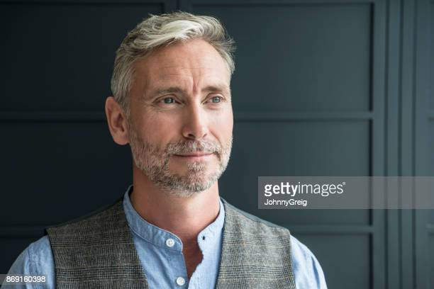 portrait of mature man with beard and grey hair looking away - looking away stock pictures, royalty-free photos & images