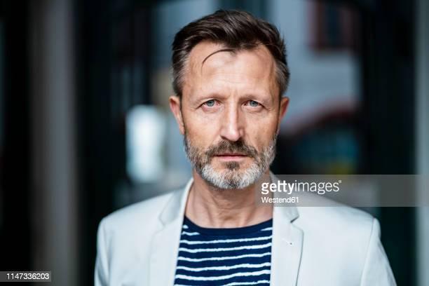 portrait of mature man with greying beard - ernst stock-fotos und bilder