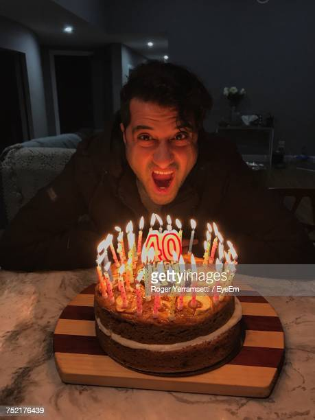 portrait of mature man with mouth open by birthday cake on table - number 40 stock photos and pictures