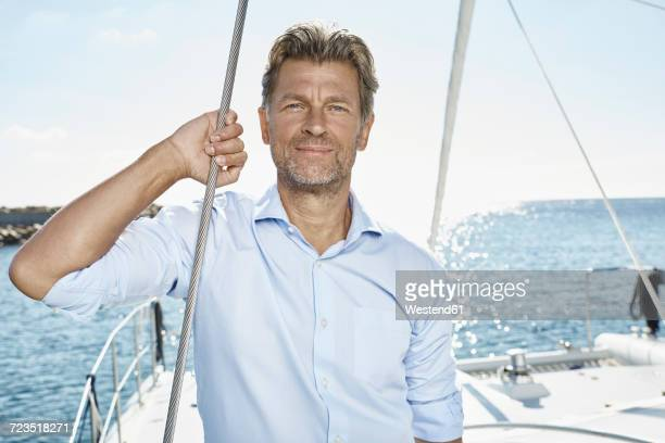 Portrait of mature man with stubble on sailing boat