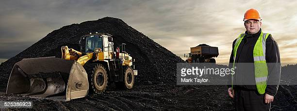 Portrait of mature man working at quarry