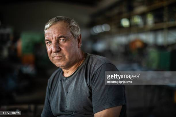 portrait of mature manual worker in metal industry - one mature man only stock pictures, royalty-free photos & images