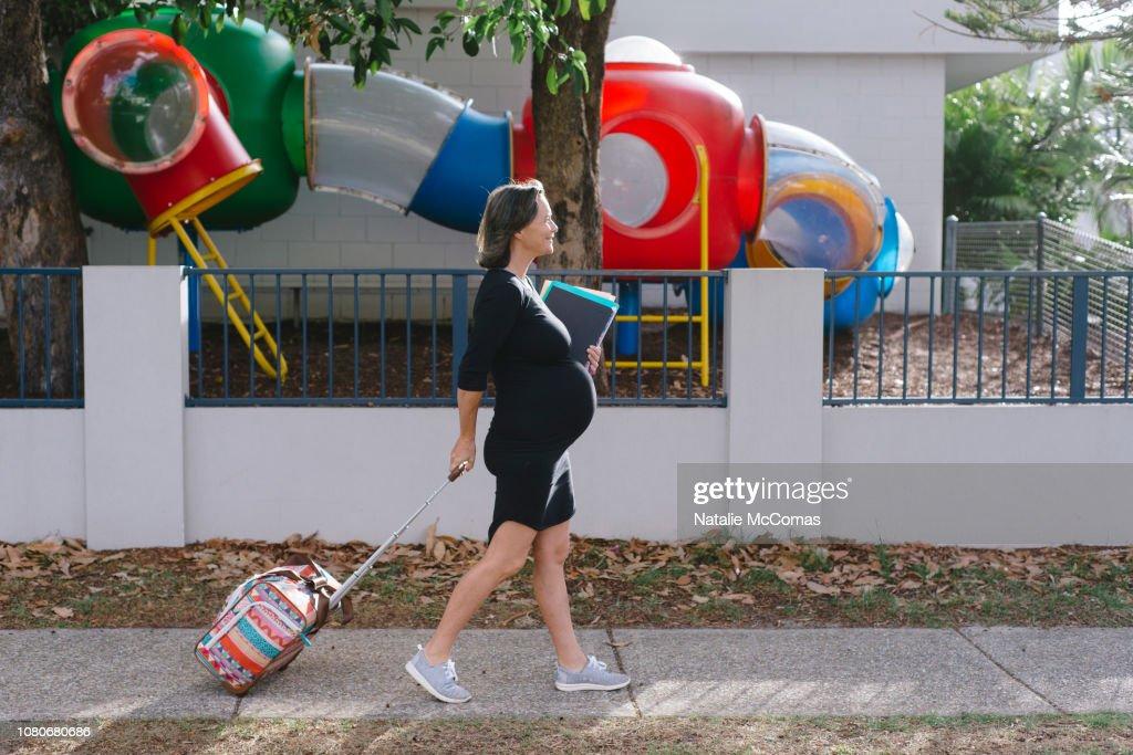 Portrait of mature pregnant female school teacher : Stock Photo