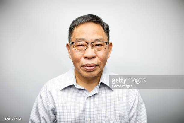 portrait of mature professional wearing eyeglasses - chinese culture stock pictures, royalty-free photos & images