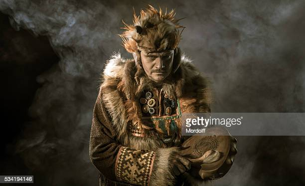 portrait of mature shaman - inuit stock pictures, royalty-free photos & images