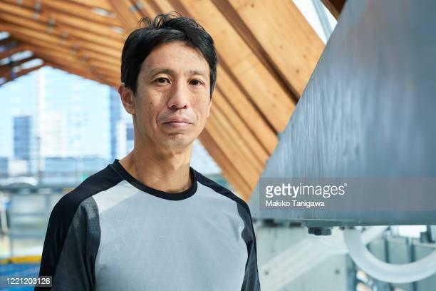 portrait of mature sportsman - スポーツ  ストックフォトと画像