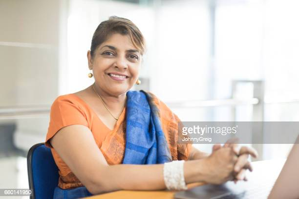 portrait of mature sri lankan woman in office - sari stock pictures, royalty-free photos & images