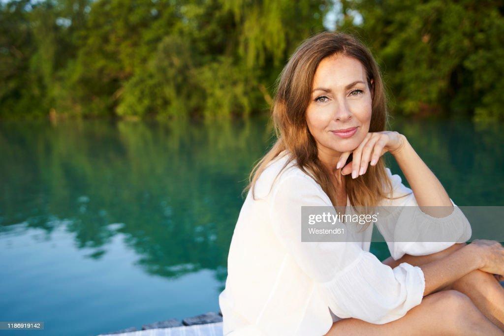 Portrait of mature woman at a lake : Stock Photo