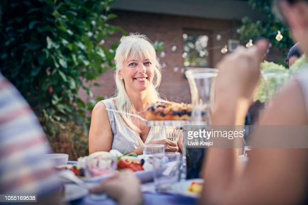 Portrait of mature woman at dinner party in garden