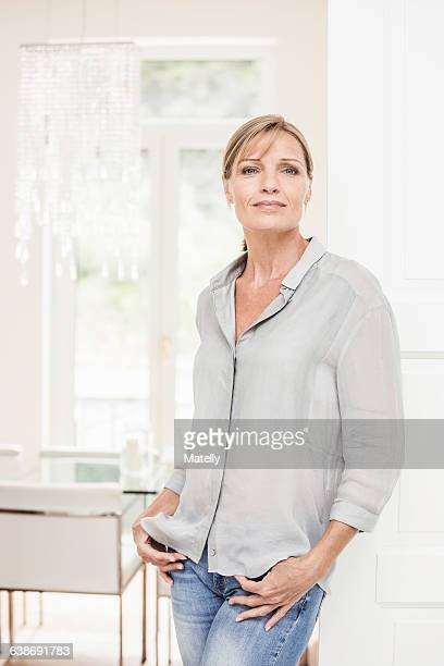 Portrait of mature woman at home