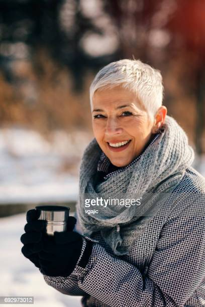 Portrait of mature woman drinking tea outdoors