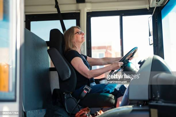 "portrait of mature woman driving a school bus. - ""martine doucet"" or martinedoucet stock pictures, royalty-free photos & images"