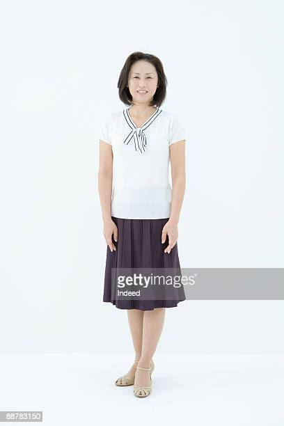 portrait of mature woman, full length - older women in short skirts stock pictures, royalty-free photos & images