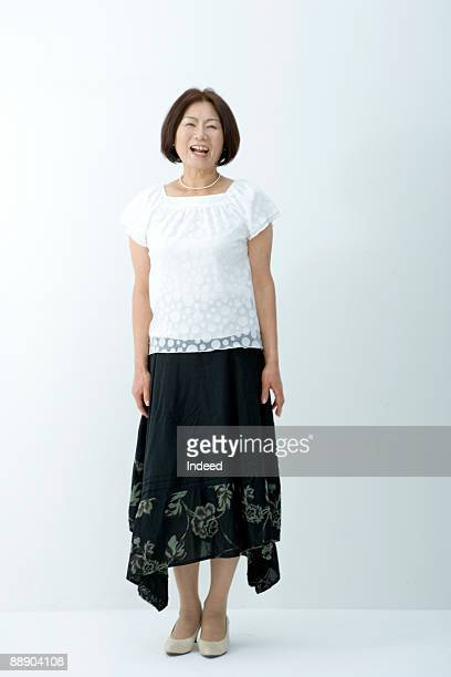 Portrait of mature woman, full length
