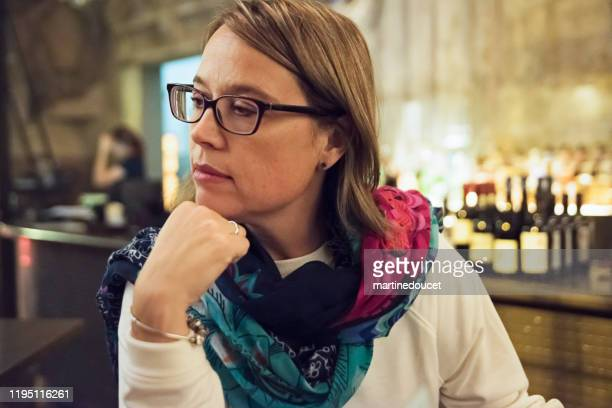 """portrait of mature woman having a drink in bar. - """"martine doucet"""" or martinedoucet stock pictures, royalty-free photos & images"""