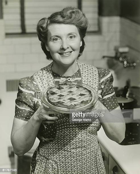 Portrait of mature woman holding pie