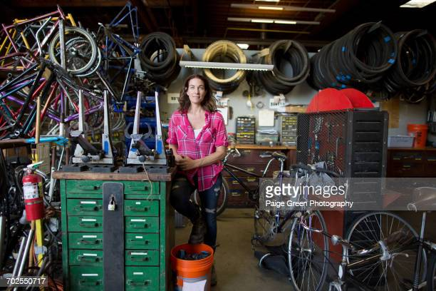Portrait of mature woman in bicycle workshop
