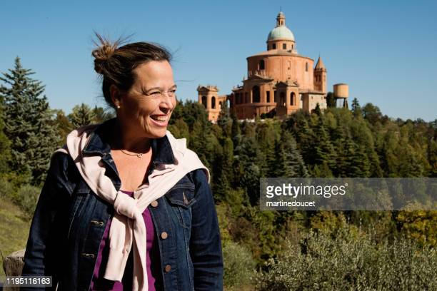 """portrait of mature woman in front of the santuary of the madonna di santa luca. - """"martine doucet"""" or martinedoucet stock pictures, royalty-free photos & images"""
