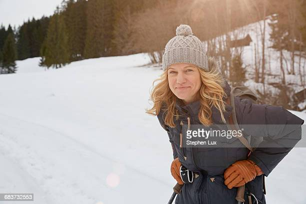 Portrait of mature woman in snowy landscape, Elmau, Bavaria, Germany