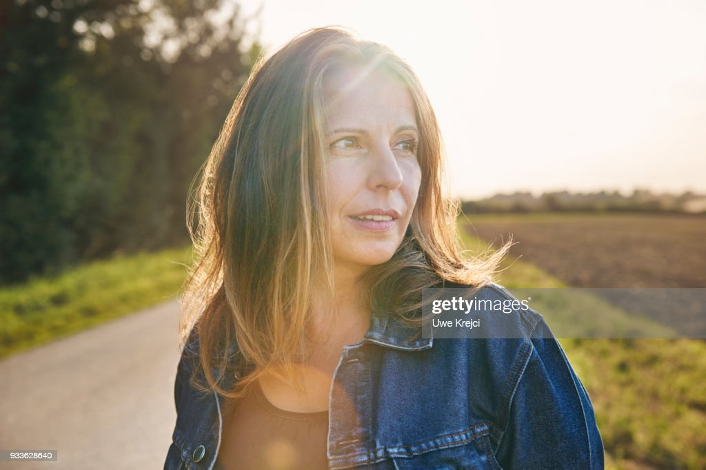 Portrait of mature woman in the countryside : Stock Photo