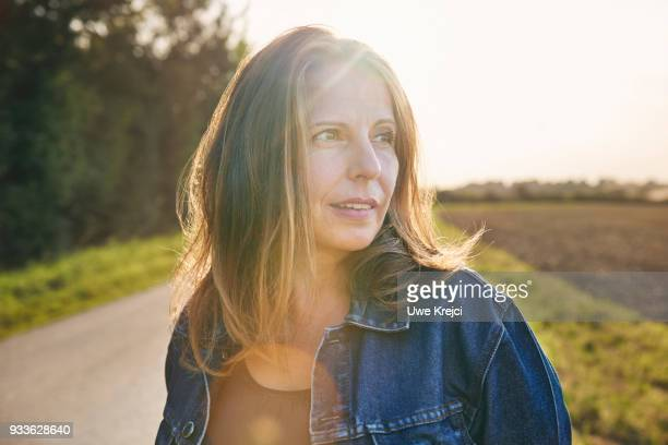 Portrait of mature woman in the countryside