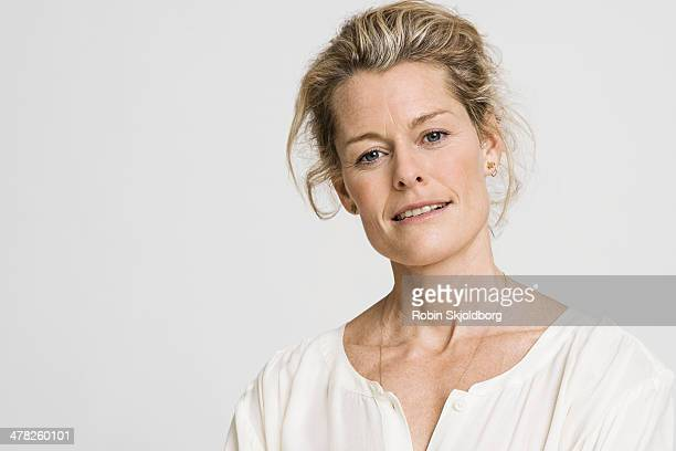 Portrait of mature woman in white shirt