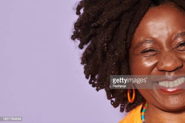 portrait of mature woman laughing - concepts stock pictures, royalty-free photos & images