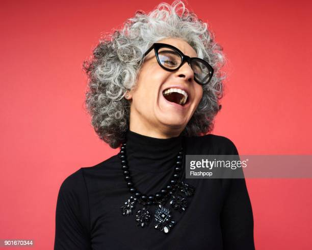 portrait of mature woman laughing - active senior woman stock photos and pictures