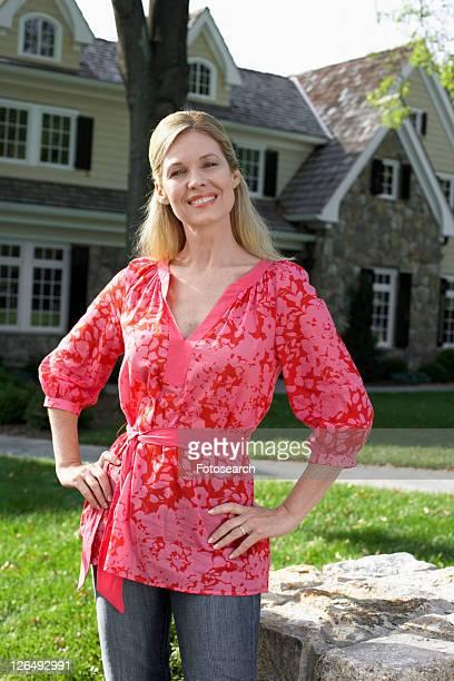 Portrait of mature woman near house, Chatham, New Jersey, USA