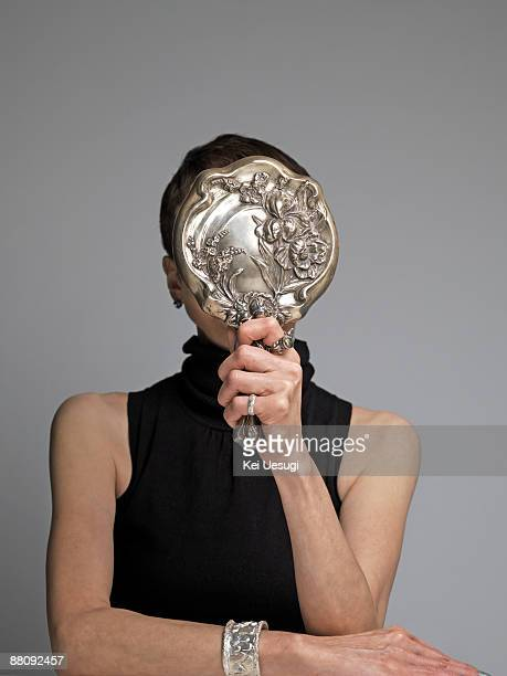 a portrait of mature woman. - hand mirror stock photos and pictures
