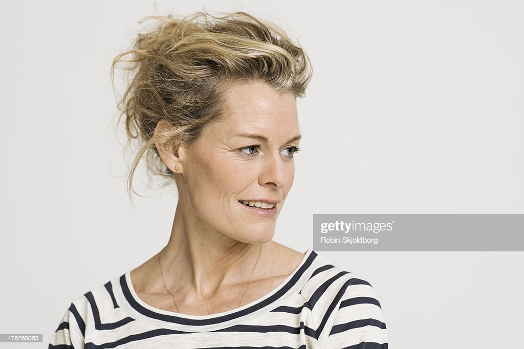 Portrait of mature woman smiling : Stock Photo
