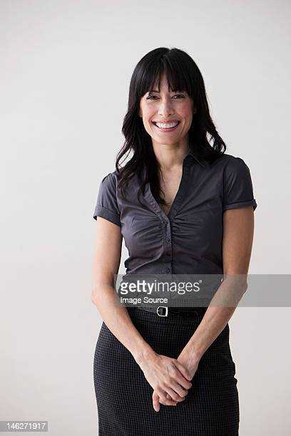 Portrait of mature woman smiling, studio shot