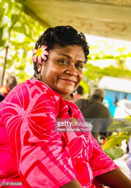 portrait of mature woman smiling while sitting outdoors - fiji stock pictures, royalty-free photos & images