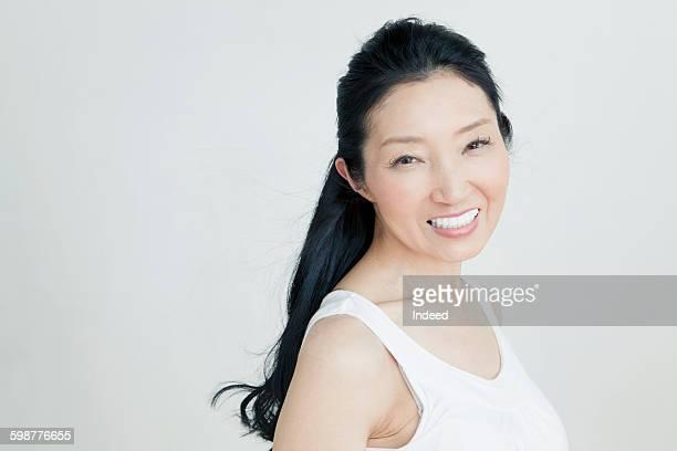 Portrait of mature woman wearing tank top
