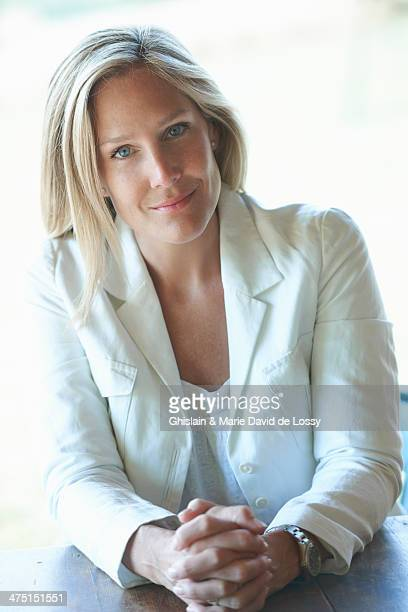 Portrait of mature woman wearing white jacket