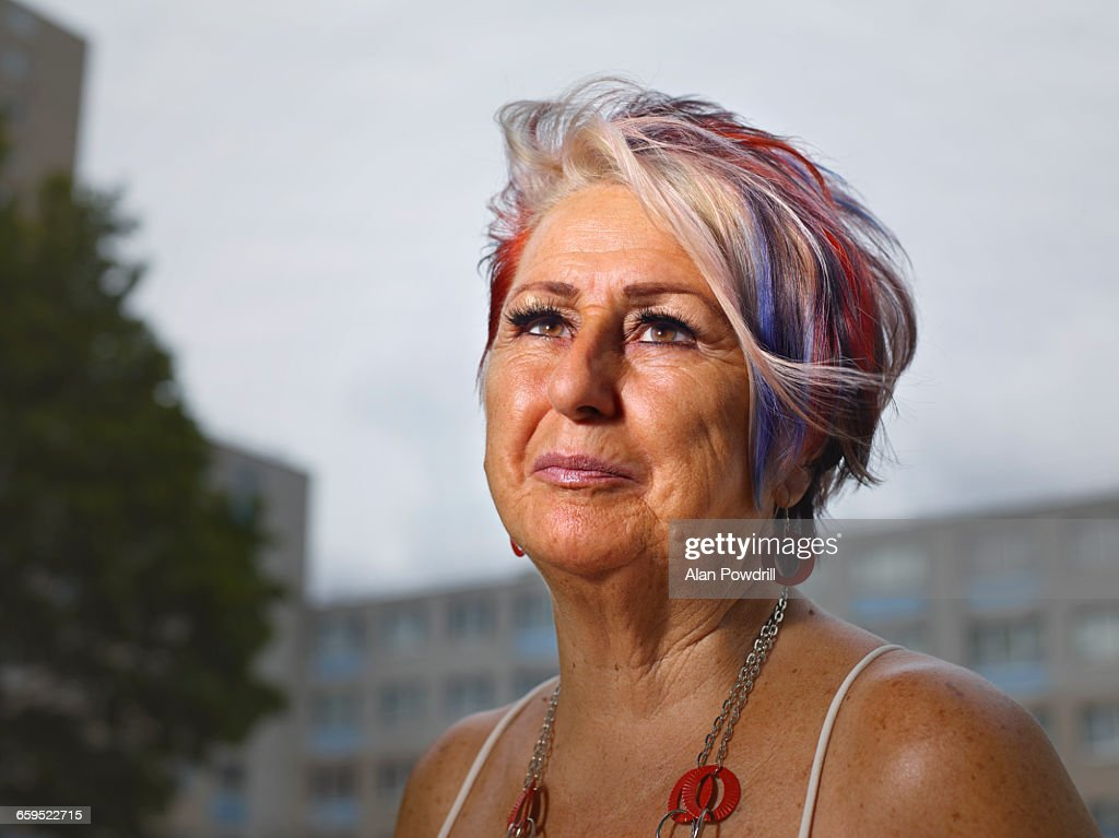 Portrait of mature woman with coloured hair : Stock Photo