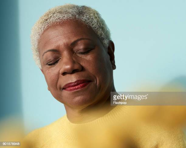 portrait of mature woman with her eyes closed - eyes closed stock pictures, royalty-free photos & images