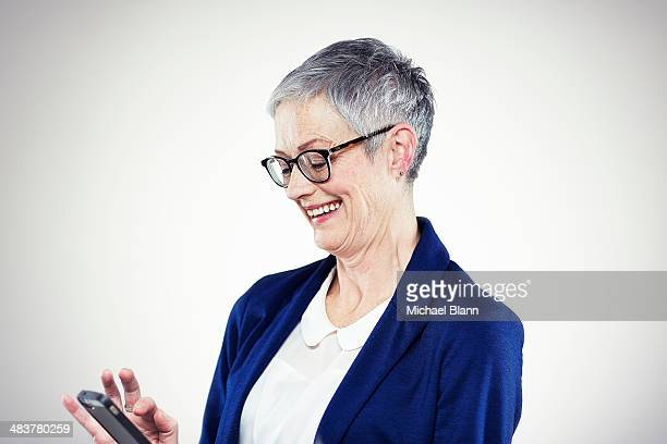 Portrait of mature woman with mobile phone