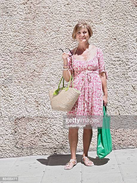 portrait of mature woman with shopping