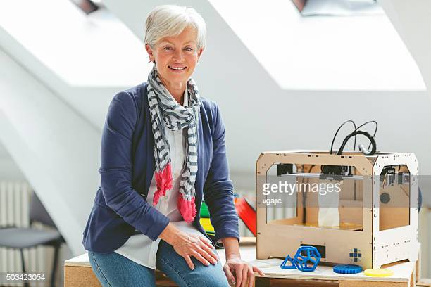 Portrait of mature woman working by 3d printer
