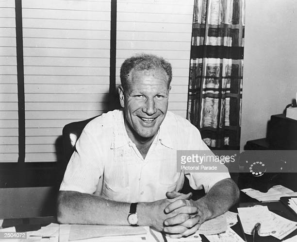 Portrait of maverick baseball executive Bill Veeck seated at his desk 1965
