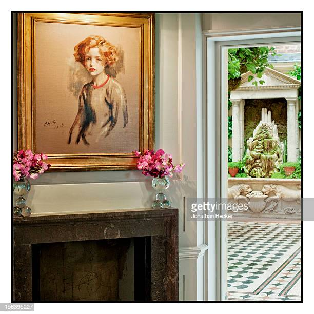 Portrait of Maxine Birley painted by her father, Sir Oswald Birley, in the downstairs dining area, and a view out to the courtyard are photographed...