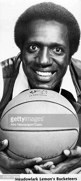 A portrait of Meadow Meadowlark Lemon basketball player and founder of the Bucketeers holding a basketball 1980